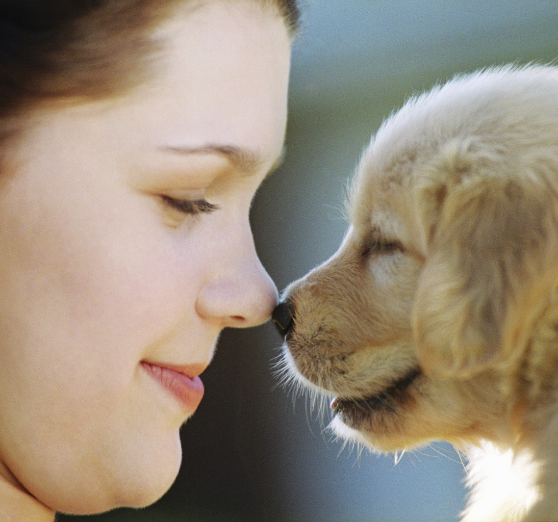 Kids Rubbing Noses with Puppy